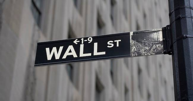 Wall Street Sign and Gray Building